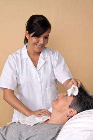nursing staff: A nurse washes the patient. Care in a hospital