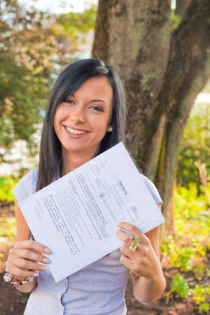 local election: Young woman with a ballot paper (Austria)