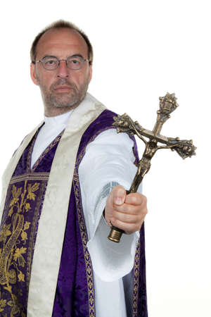 A Catholic priest with a cross in his hand photo