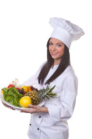 bulging: Young chef with a bulging fruit and vegetable box Stock Photo