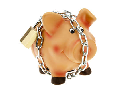 A happy piggy bank with a chain and lock secured. Security while saving. Stock Photo - 9523882