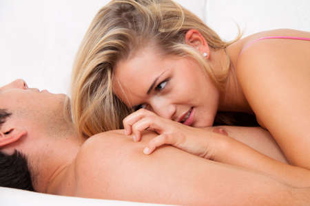 Couple in bed with sex and affection. Love and eroticism in the bedroom. photo