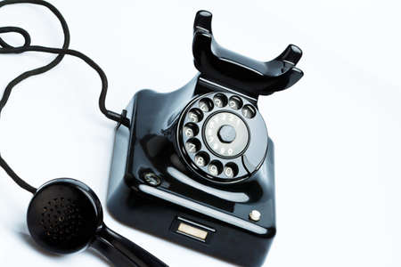 An old, old landline telephone. Phone on a white background. Stock Photo - 9550469