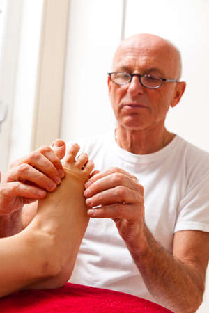 Relaxation, peace and well-being through massage. Reflexology photo