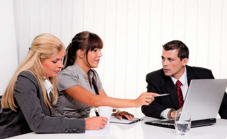 tolerance: Successful young team at a meeting in the office