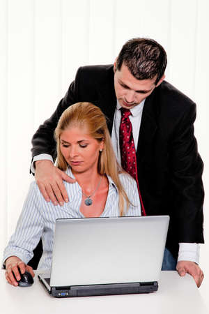 Sexual harassment of women at work in the office photo