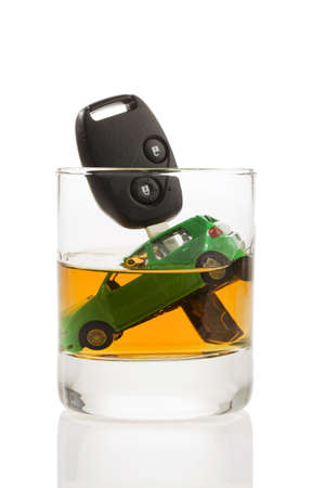 drinking and driving: Car keys and a jar of alcohol on a table