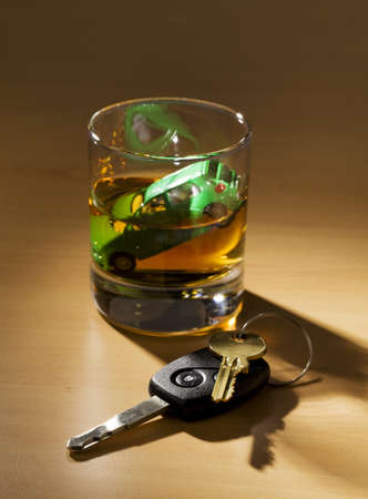 Car keys and a jar of alcohol on a table Stock Photo - 9594773