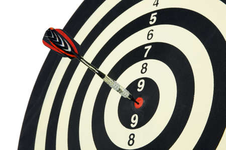 dart board: An arrow game with a dart has hit the mark. Stock Photo