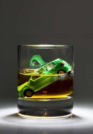 Car keys and a jar of alcohol on a table photo