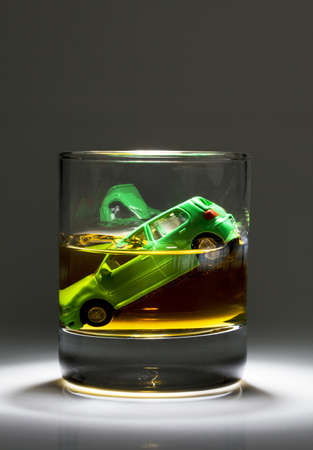 drink and drive: Car keys and a jar of alcohol on a table