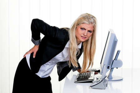 Young woman with pain in the back office. Stock Photo - 9637710