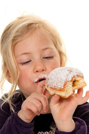 snacking: Child in a carnival, with donuts. Donuts. against white background