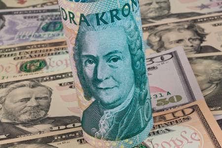 Swedish krona, the currency of Sweden. American dollar bills. photo
