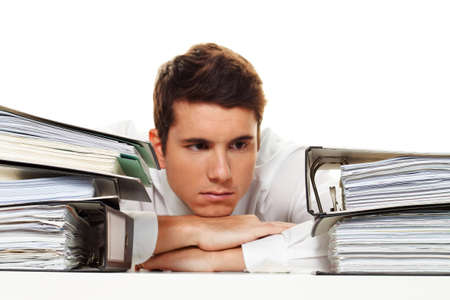 nudes: A manager in the stress with stacks of files. Bureaucracy in administration Stock Photo