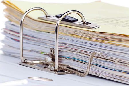 bureaucratic: A file folder with documents and papers. Retention of contracts.