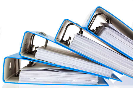 filing document: File folders with documents and papers. Retention of contracts. Stock Photo