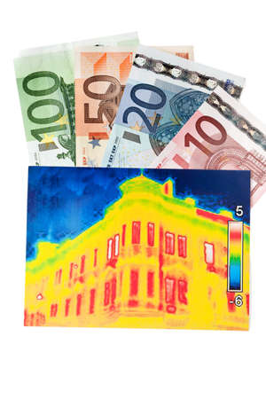Saving energy through thermal insulation. House with thermal imaging camera photographed. Stock Photo - 9637830