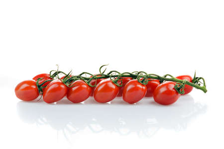 cherry tomatoes: Small fresh tomato on white background. Cherry tomatoes, vegetables of the season Stock Photo