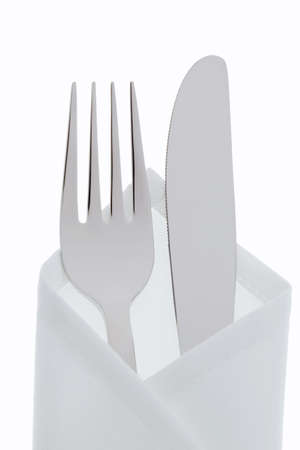 A knife with a fork and plate. Place setting for a dinner in the restaurant. photo