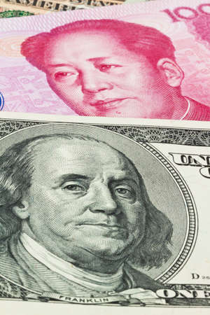 parity: Chinese currency yuan and U.S. dollars amerkinaische bills