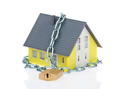 padlock shut off: A detached house with a chain and lock shut off. Alarm and security. Stock Photo