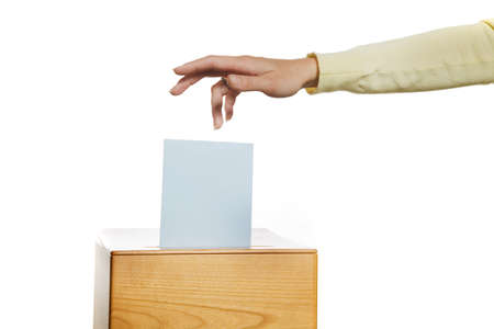 A young woman in an election shall deliver their vote. Ballot at the polling station. Stock Photo - 9751557