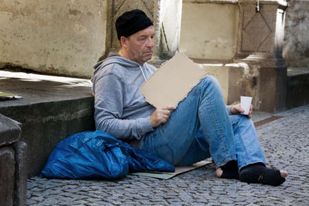 hartz 4: A homeless person looking for new work. Arbietsloser beggars living on the street.