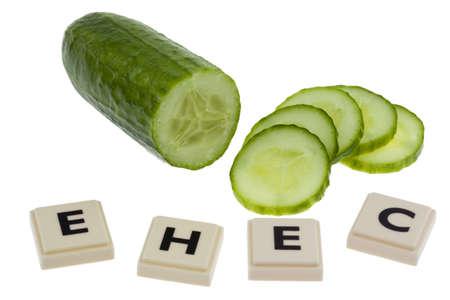 A cucumber as a symbol of EHEC disease Stock Photo