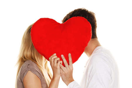tenderly: Loving couple kissing behind a heart. Love is beautiful. Secret love