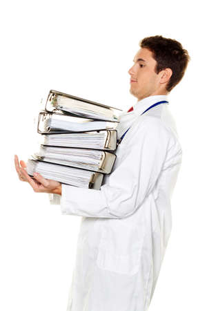 burocracia: A doctor in trouble with stacks of files. Bureaucracy in the hospital.
