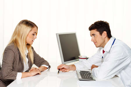Doctors call. Patient and doctor talking to a doctors office photo