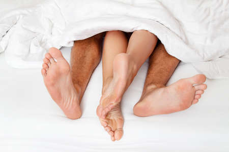 Dier a couple feet in bed. Love, Sex and partners. Stock Photo - 9751549