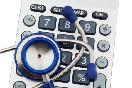 generic medicine: A stethoscope is located on a calculator. Health care costs