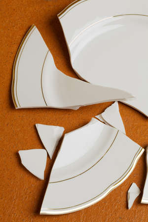 household accident: A broken dish is on the floor in the kitchen Stock Photo