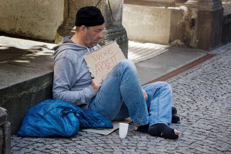 vagabond: A homeless person looking for new work. Unemployed beggars living on the street.
