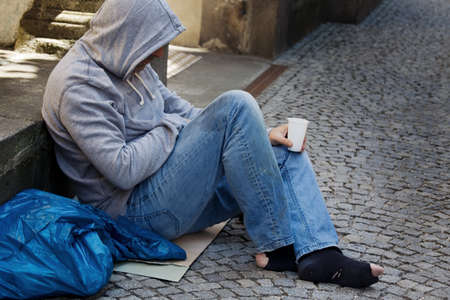 A homeless person looking for new work. Unemployed beggars living on the street. Stock Photo - 9751552