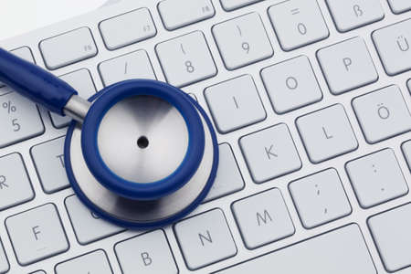 medical records: A stethoscope is on the keyboard of a computer