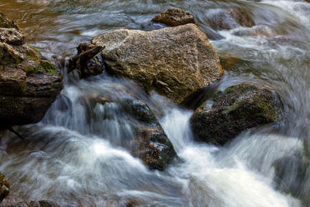 A cool stream of water and rocks in the mountains. Unspoiled nature. Stock Photo - 9838005