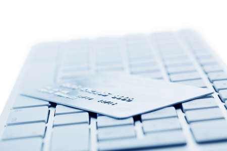 e banking: On the keyboard of a computer is a credit card. Online banking and shopping Stock Photo