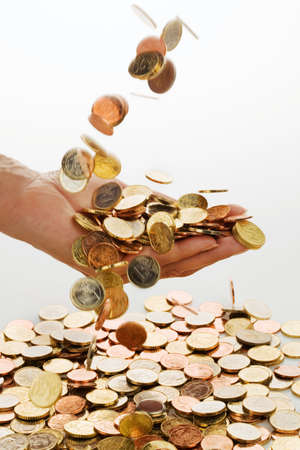 alimony: The hand of a woman with euro coins against white background