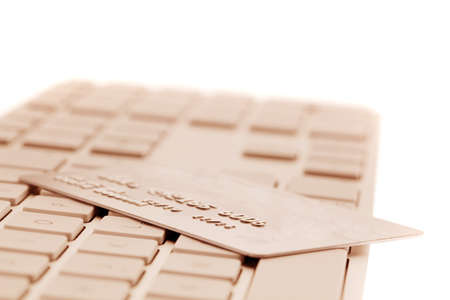 On the keyboard of a computer is a credit card. Online banking and shopping photo