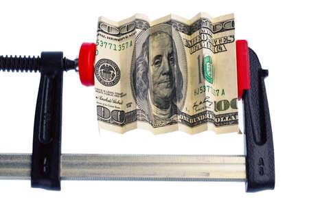 Financial or economic metaphor: dollar bill in clamp photo