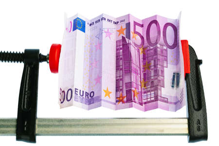 pinched: Financial or economic metaphor: euro bill in clamp Stock Photo