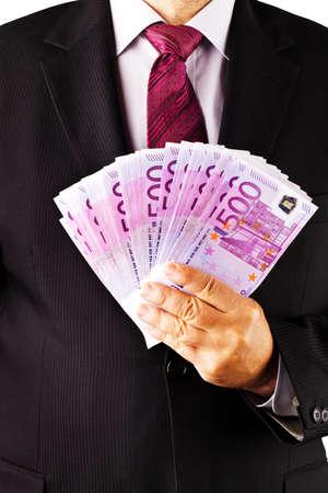 rendite: Un manager con un sacco di bollette di 500 euro in mano. Archivio Fotografico