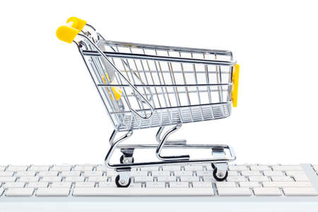 A cart and a computer keyboard. Photo icon Online Shopping photo