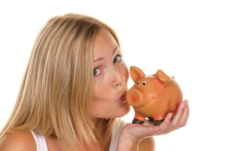 precaution: A young woman saves money and coins for the future. Pension and savings.