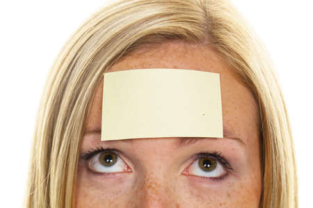 recall: A young woman with a notepad on forehead Stock Photo