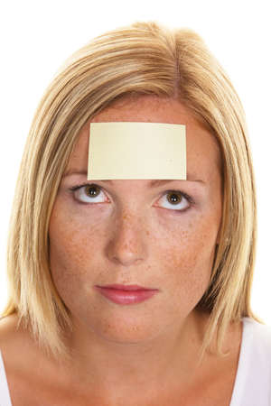 incidence: A young woman with a notepad on forehead Stock Photo