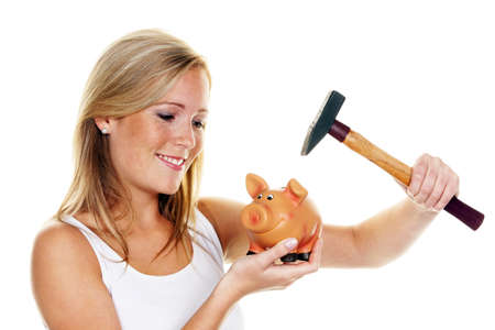 provisions: A young woman with a hammer kill her piggy bank.